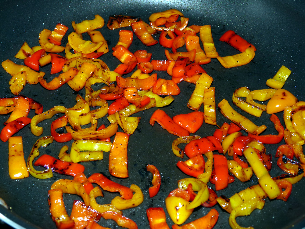 """Cut peppers into 1"""" pieces and sauté over medium high heat until browned around the edges"""