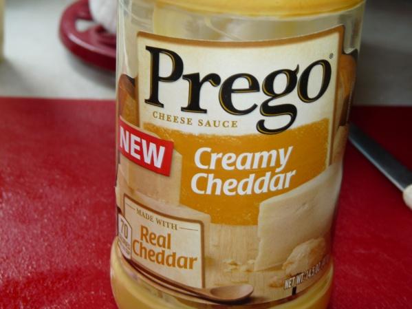 Add Prego Creamy Cheddar sauce