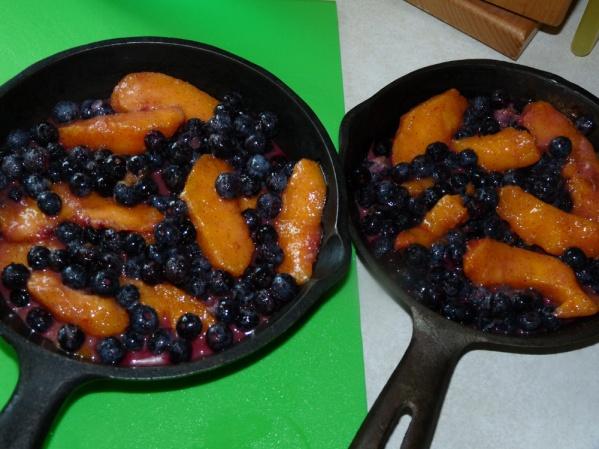 Divide fruit filling between two skillets