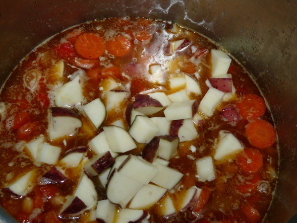 Add potatoes to pot and cook until fork tender