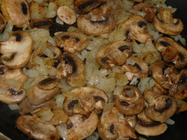 Sauté onions until translucent. Add mushrooms and continue for several minutes until they are lightly browned