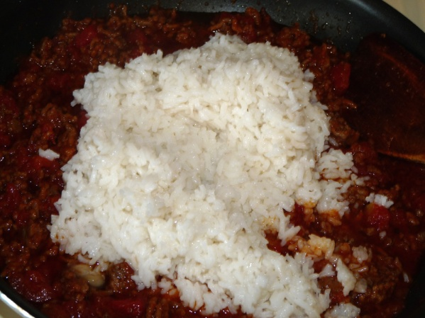 Add rice to skillet
