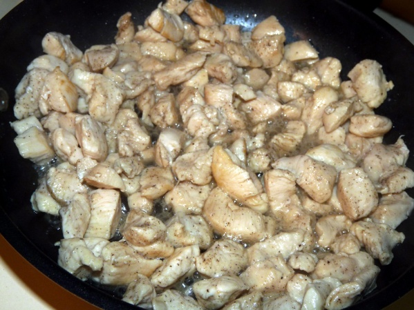 Sauté chicken in a heated skillet with a drizzle of oil just until It is no longer pink