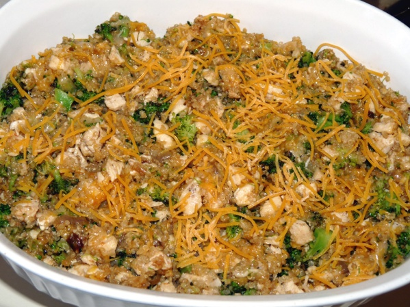 Pour into greased or sprayed casserole dish and sprinkle with a little more shredded cheese
