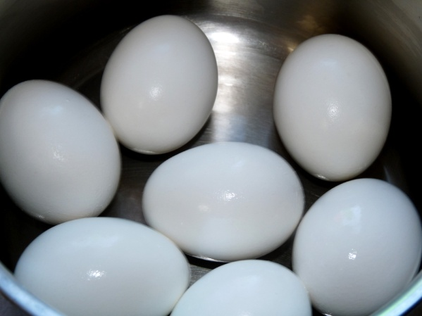 Boil eggs and cool