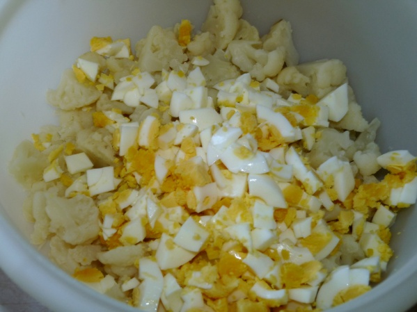 Peel and dice eggs into bowl of cauliflower