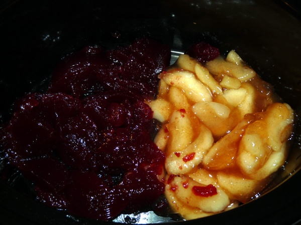 Empty a can of cranberry sauce and a can of apple pie filling into an empty crockpot. Mix together.