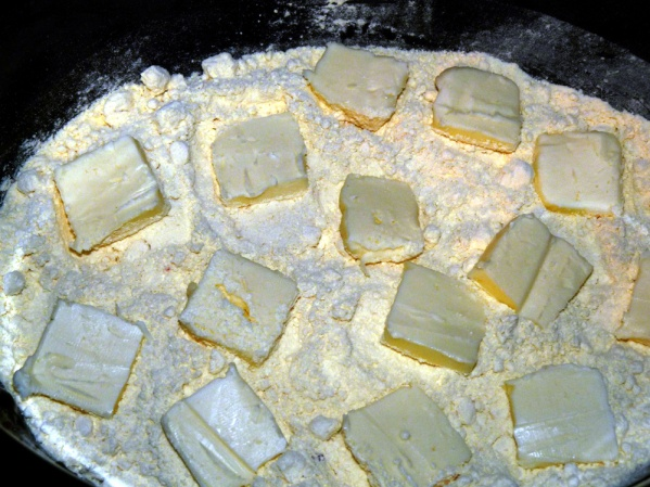 Slice 1/2 cup (1 stick) of cold butter thinly and spread over the cake mix layer.