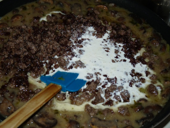 Add beef and stir well. Add cream and stir until thickened