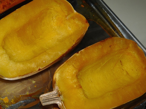 Roast spaghetti squash until you can easily pierce the skin with a fork