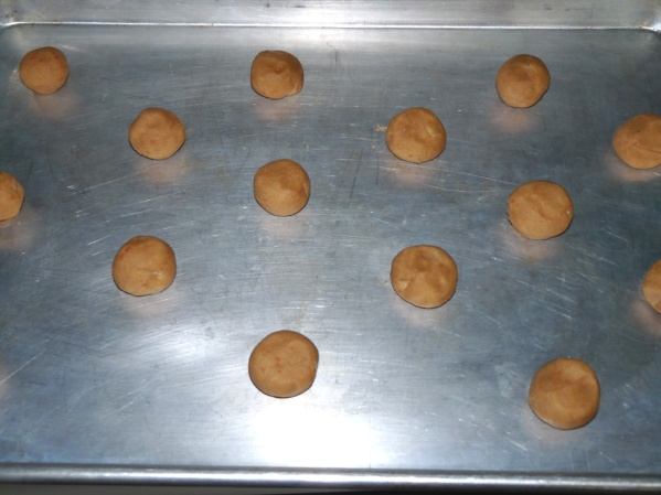 "Using a cookie scoop and your hands, roll into balls and place at least 1 1/2"" apart"
