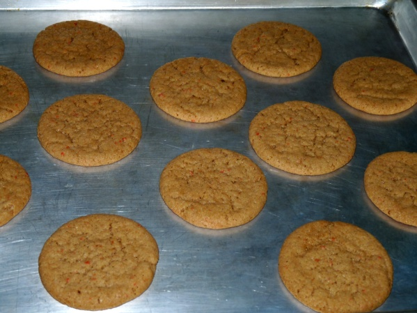 Bake for 10-12 minutes until cookies are raised and beginning to crack. They will finish setting up as they cool.