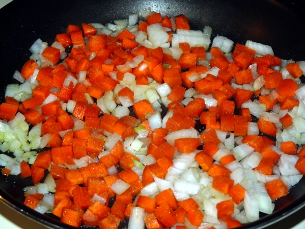 Sauté onions and carrots in a drizzle of oil until onions are translucent
