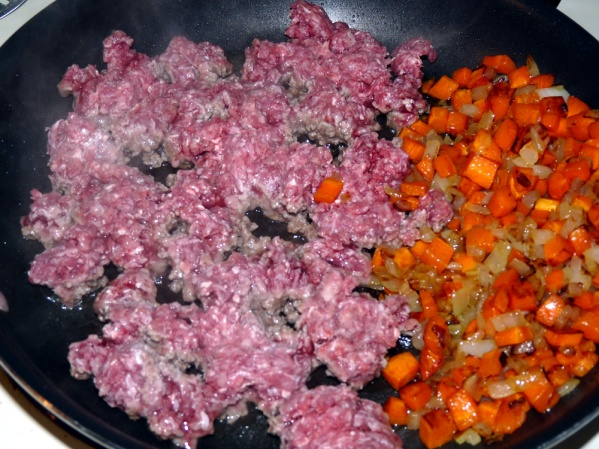 Fry beef until browned then break into smaller pieces