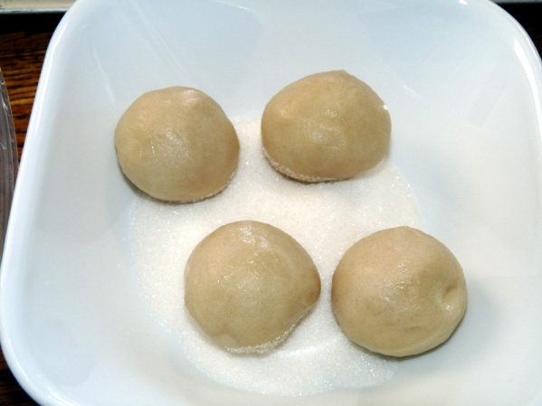 Roll each piece into a ball and roll in sugar.