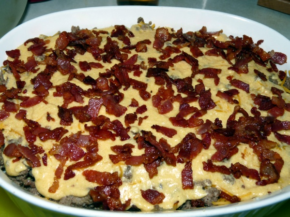 Layer ground beef, 1/2 of remaining cheese sauce, half of remaining cheese. Spread remaining cheese sauce, reamining shredded cheese and top with bacon.