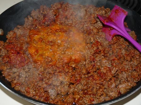 Add tomato paste, cherry tomatoes and garlic