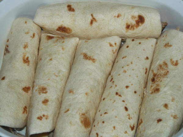 Spray or grease baking dish and place tortillas in the dish as rolled