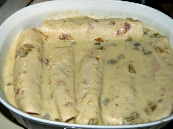 Pour sauce over enchiladas and sprinkle with remaining cheese