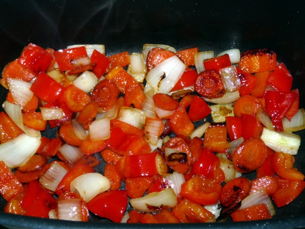 Sauté carrots for several minutes then add onion and bell pepper. Sauté for several minutes until the onion is just beginning to turn translucent.