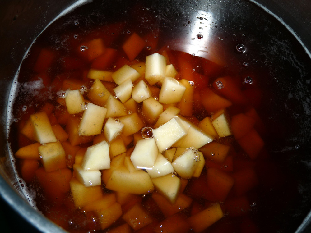 Add broth and potatoes to soup pot
