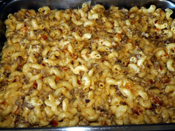 Spread pasta mixture into prepared pan