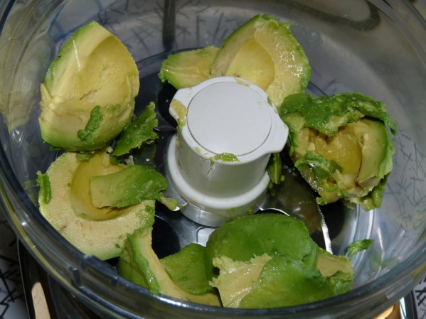 Scoop avocados into your food processor