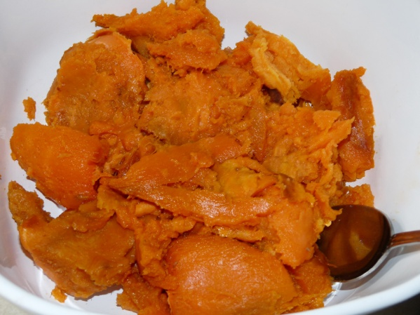 Scoop sweet potatoes into a container and store until used.
