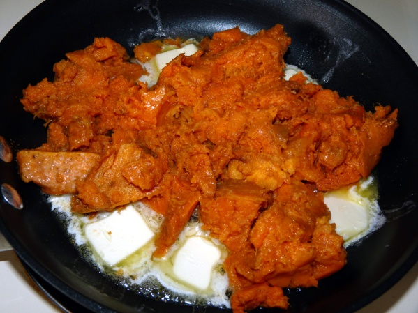 Place sweet potatoes in a nonstick skillet over medium high heat with slices of butter until melted.
