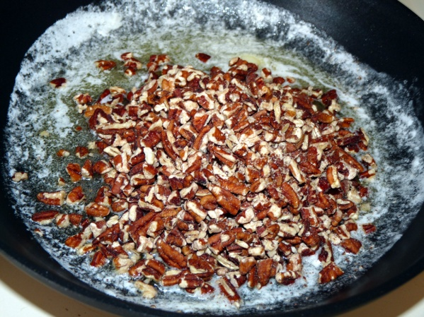 Add chopped pecans and stir to coat