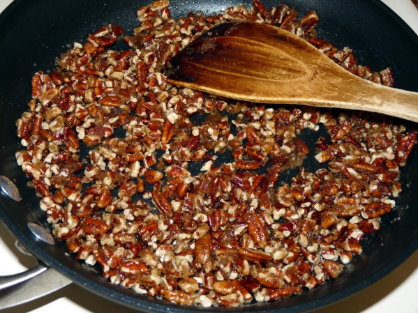 Cook, stirring constantly, until sugar is melted and the mixture begins to thicken and caramelize