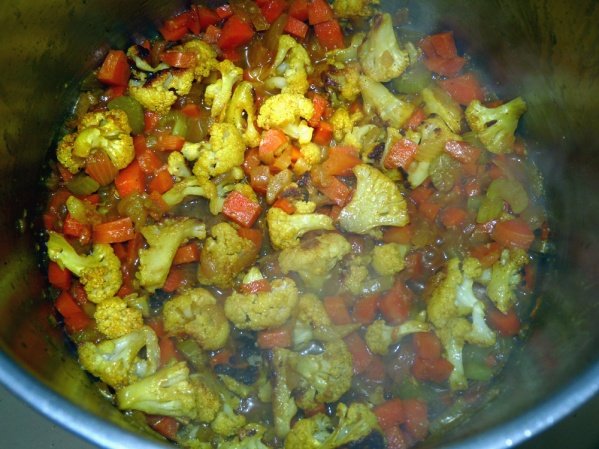 Add cauliflower and when again heated through, stir in coconut milk, juice and zest of one small lime and salt.
