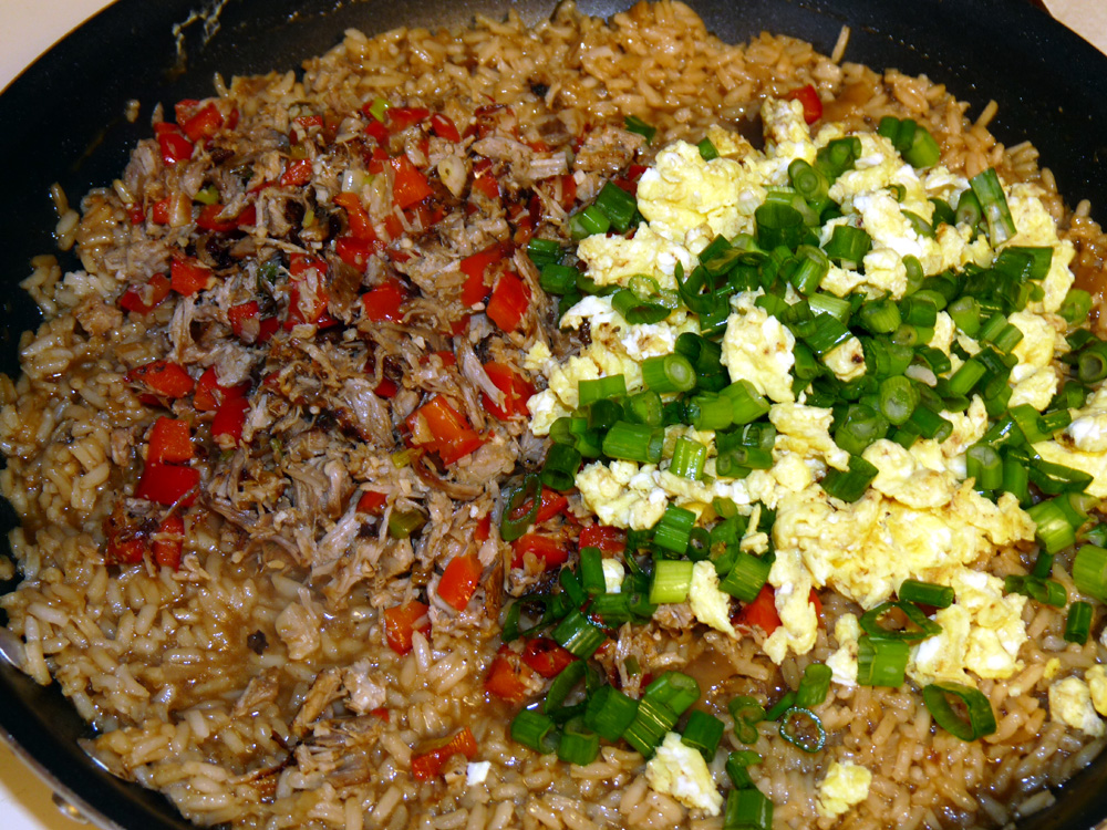 Add scrambled eggs and green onions to skillet and stir well