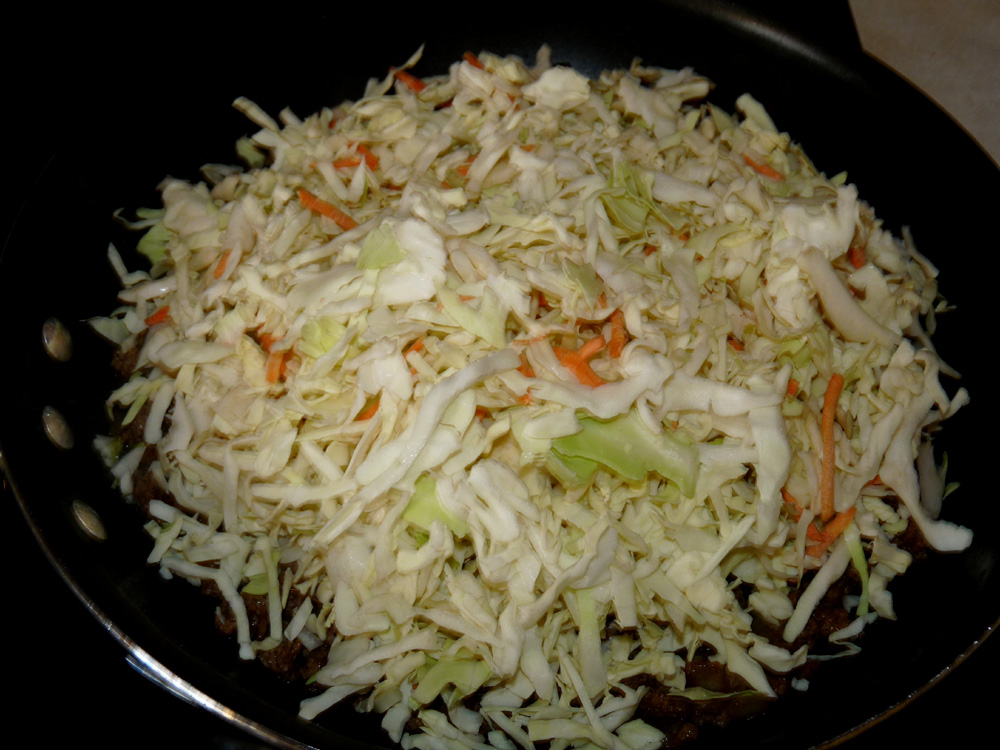 Add bag of coleslaw and stir well