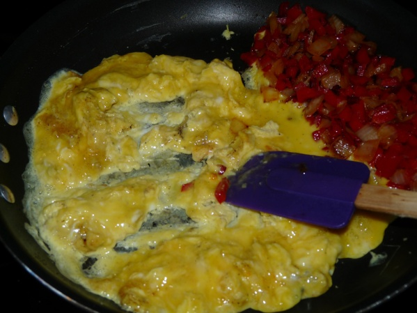 Push onion and pepper aside and scramble eggs in the same skillet. Break eggs into small pieces