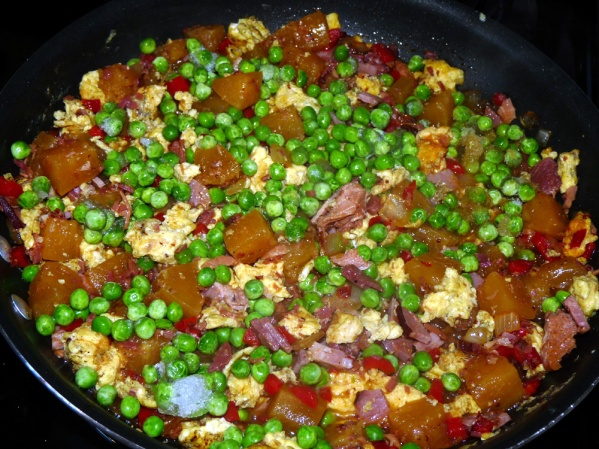 Add frozen peas and heat through