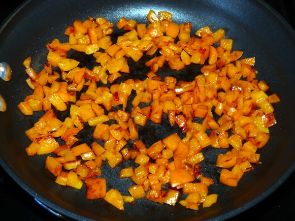 Sauté peppers in a drizzle of oil until they are browned around the edges.