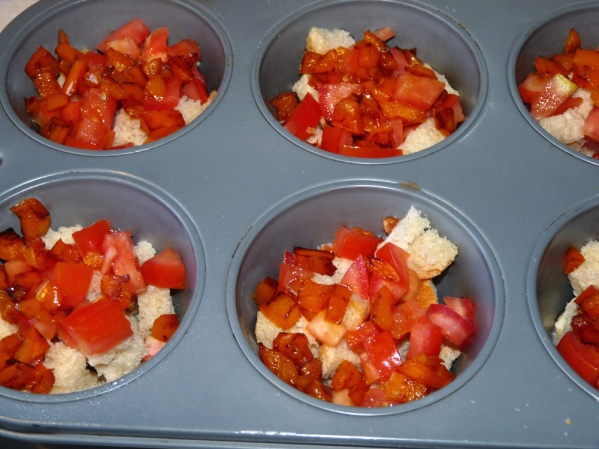 Layer tomatoes into muffin cups next.