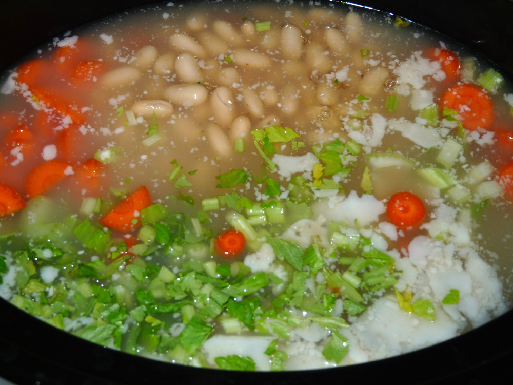 Add broth, beans, carrots, celery and onions to crockpot