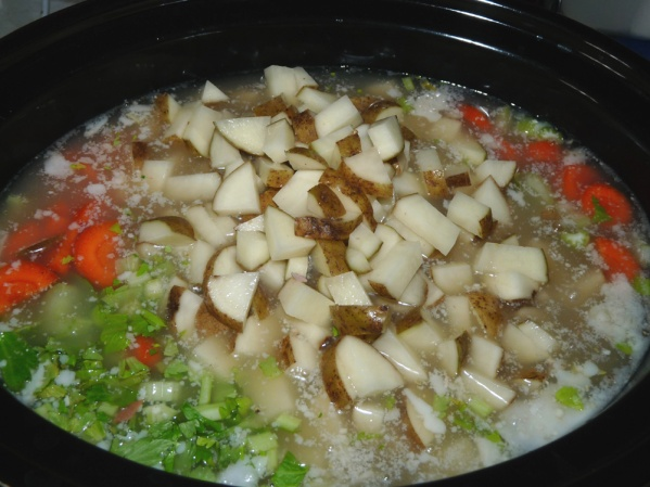 Add potatoes, scrubbed and cut into cubes