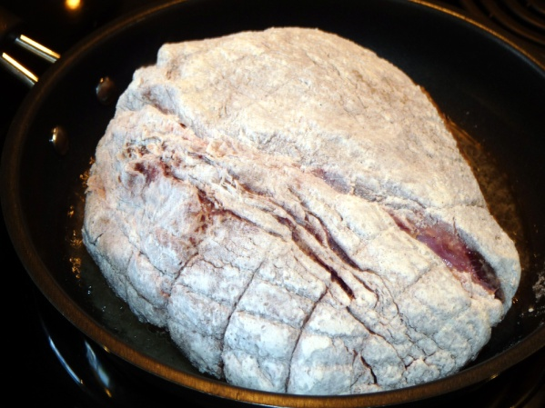 Dredge roast through flour, covering all sides