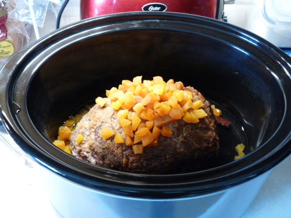 Place roast in crockpot. Cover with diced dried fruit (I used apricots) and add 1/2 cup water to pot.