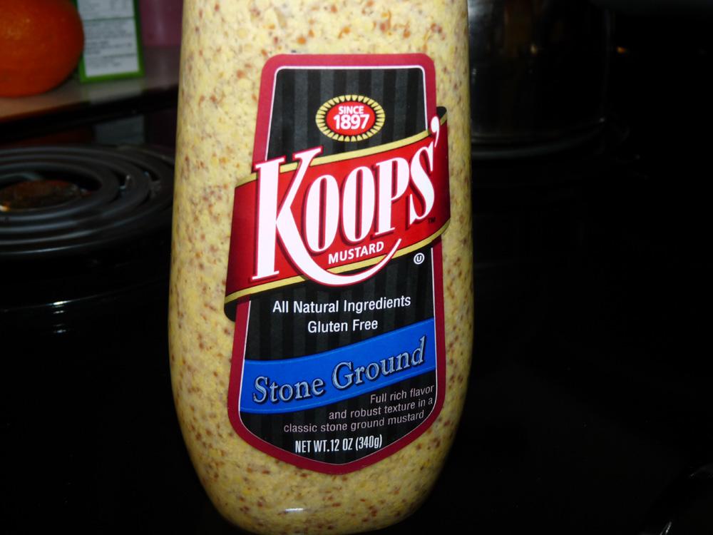 Spread 1/4 cup mustard over ham. I chose a stone ground mustard