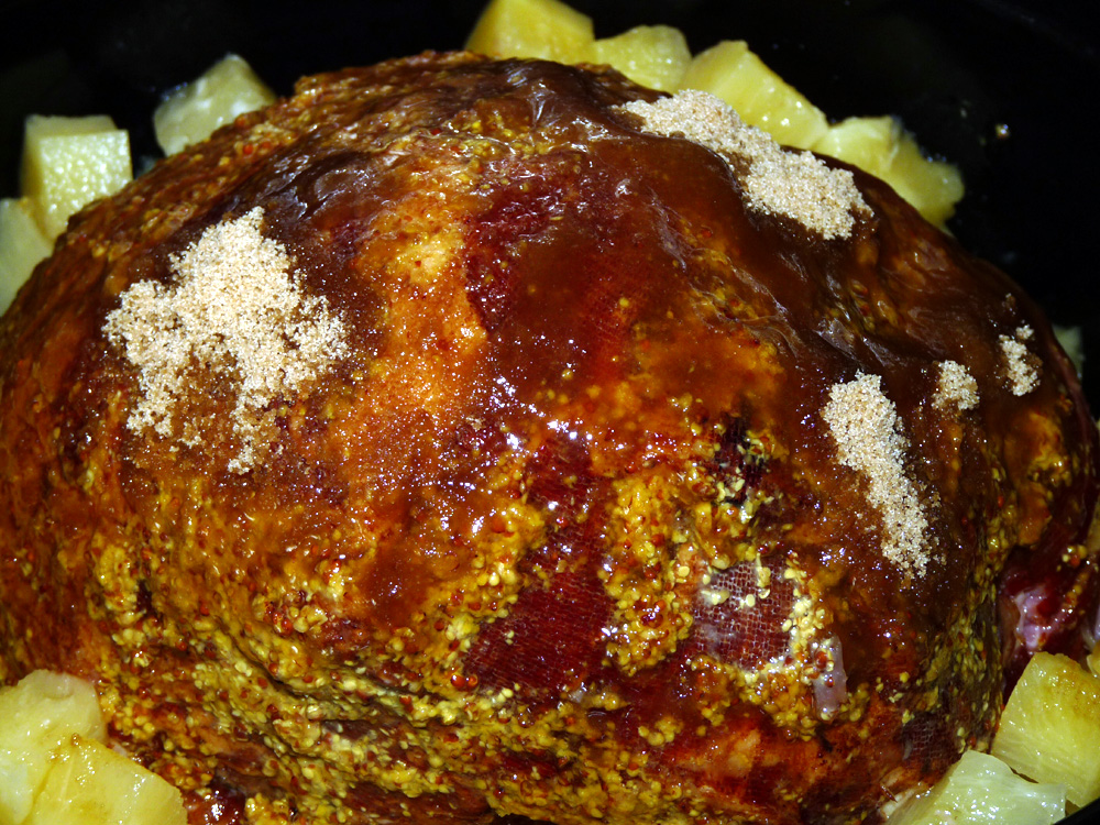 Pour 20 ounce can pineapple chunks and juice over ham taking care not to wash away mustard and brown sugar