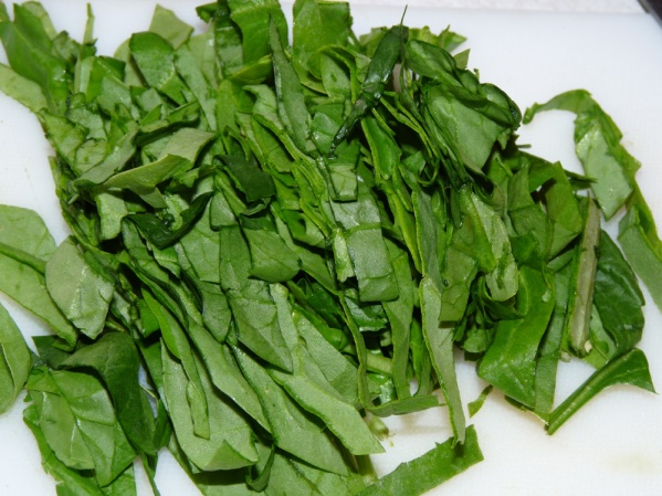 Cut spinach into strips (chiffonade)