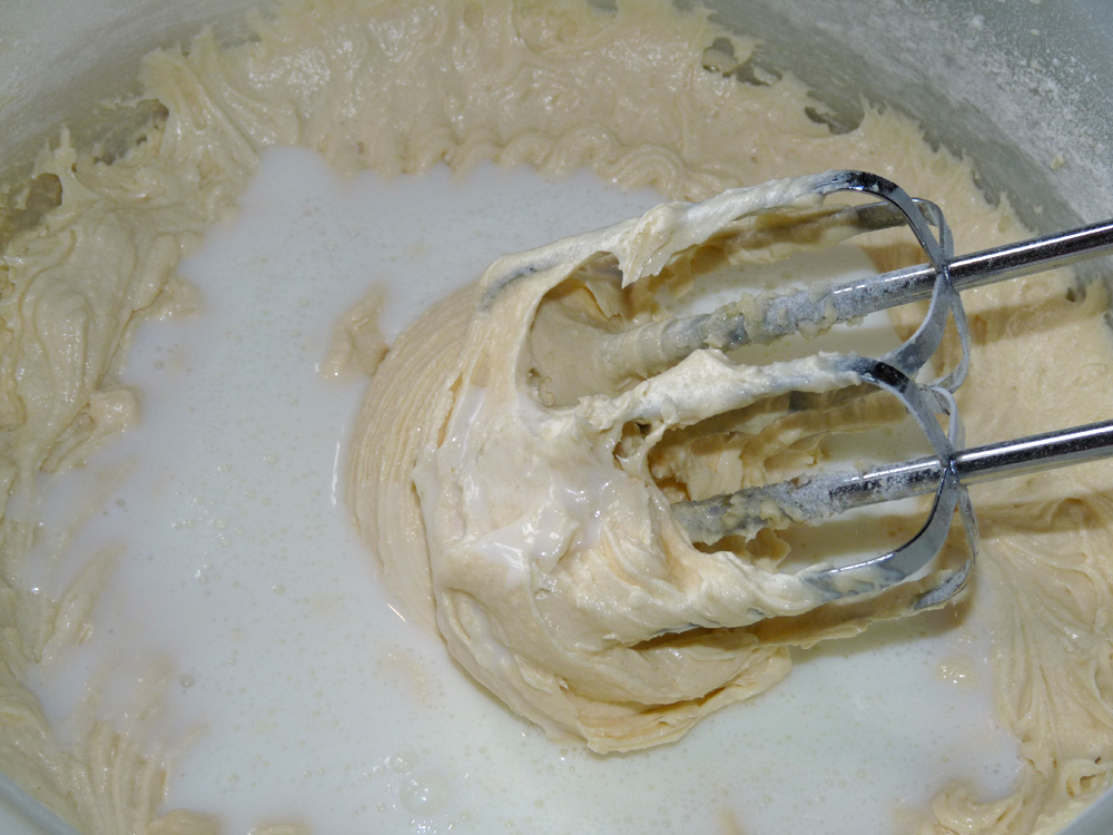 In a separate bowl whisk flour and baking soda. Beat into mixture alternating in 3 additions each.