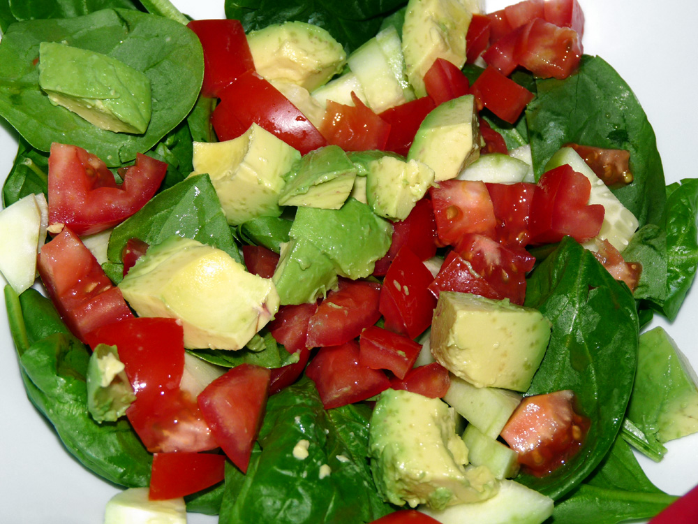 I assembled the salad add spinach leaves, avocado and diced tomatoes,