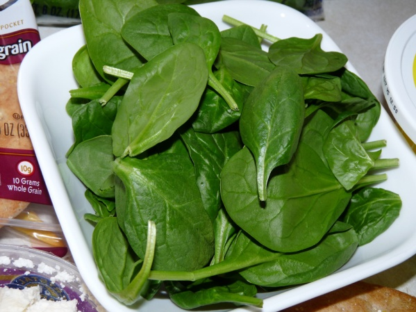 Line pockets with fresh baby spinach