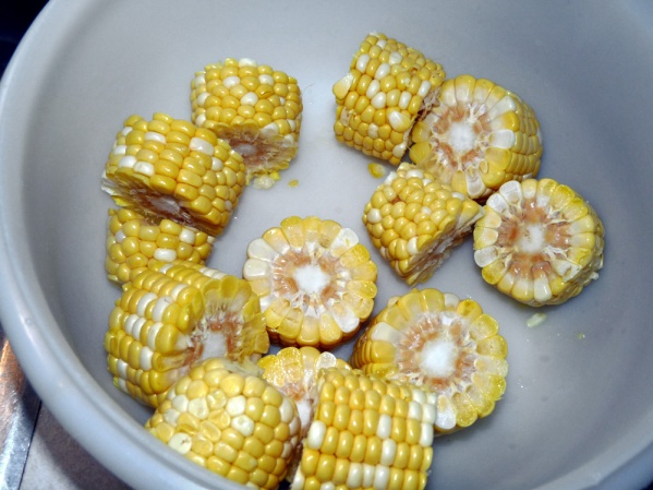 "Slice corn into 1"" chunks. Melt butter, add salt and pepper and toss with corn."