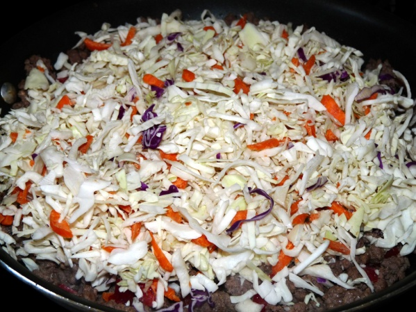 Add coleslaw and cook for another 10 minutes, stirring occasionally.